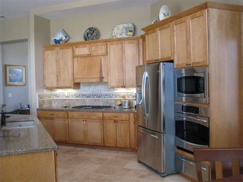 grey quartz countertops  natural wood kitchen cabinets