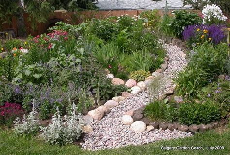 dry creek bed landscaping ideas dry stream bed on slope sloped hillside landscaping