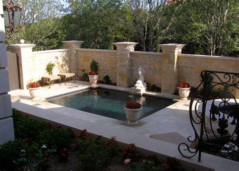 backyard oasis  fountain soaking pool hot tub