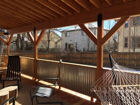 covered deck with corrugated metal roof and rails