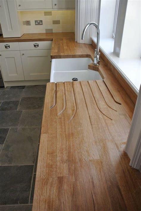 cream kitchen, black floor, wooden worktop   Google Search