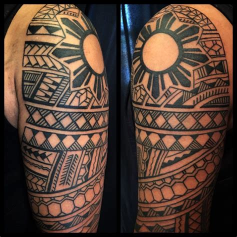 filipino cross tattoo design and tattooing by samuel shaw on the