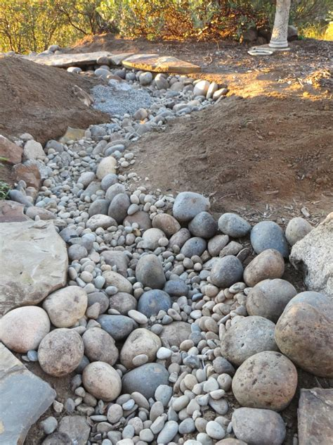 how to make a dry creek bed creating a dry creek bed with tips for a natural look