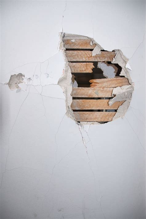 fix hole in wall how to fix a small hole in drywall step by step