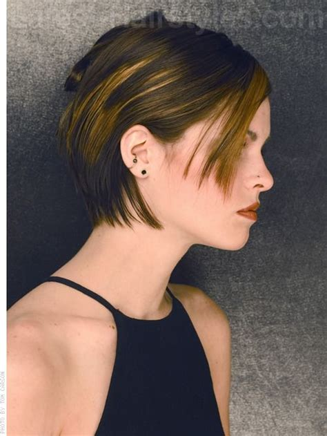 wearing very short texturized hair in a straight style for women of color short straight haircut with texture short hair pixie