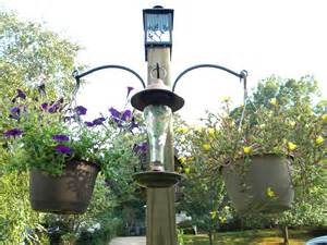 diy freestanding bird feeder and flower post we call it