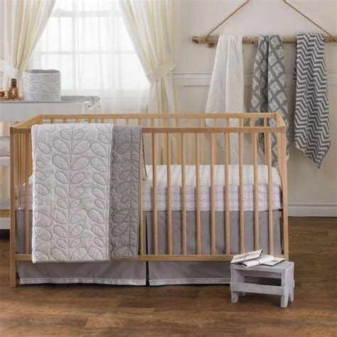 grey and white quilted crib comforter by lolli living