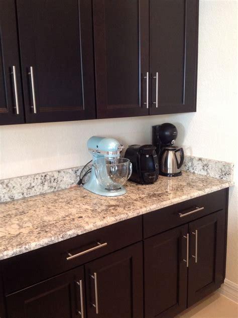 Dark (espresso) cabinets with granite countertop and 5 1/2
