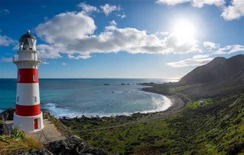wallpaper  sky clouds  ocean coast lighthouse
