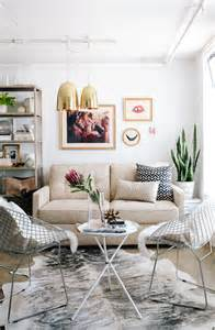 modern chic living room ideas modern chic living room with sheepskin chairs and gold light pendants pinterest home decor