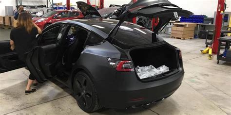 What Does Co Interior Mean Tesla Model 3 S Back Seats Will Fold Flat With 5 6 Of