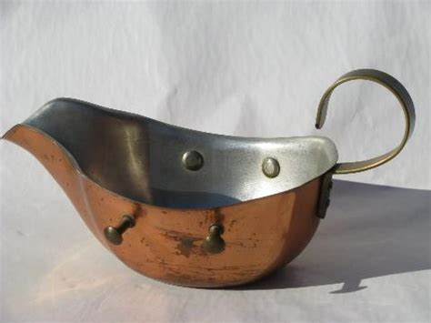 sauce boat or gravy warmer copper and brass gravy or sauce boat pitcher on candle