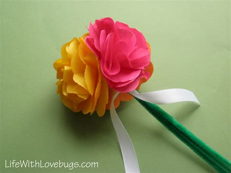 tissue paper flower centerpiece with lovebugs