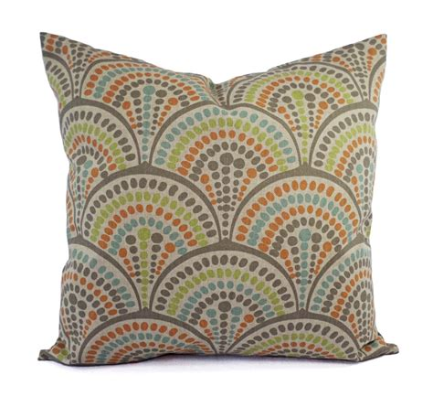 orange green and blue decorative pillow by castawaycovedecor