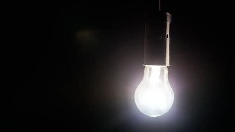 swinging light swinging light bulb stock footage video 5573414 shutterstock