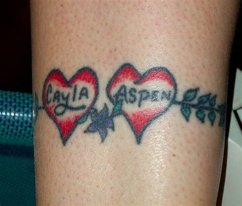heartbeat tattoo with two names two love heart with names and flowers tattoo heart tattoos