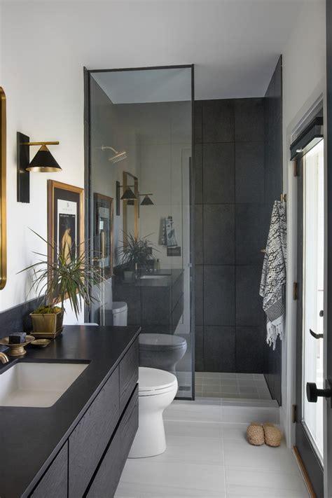 eclectic guest bathroom  large black tile