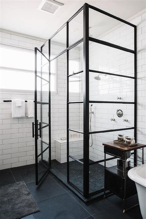 Steel Shower Baths tiles lined with small shower bench over a black grid shower floor