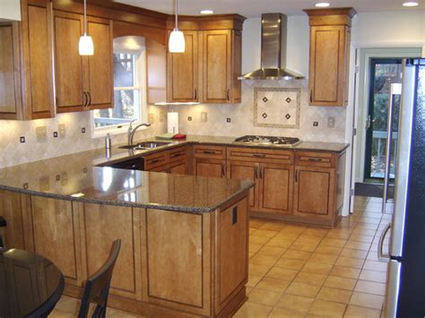 maple kitchen cabinets lowes providence maple in praline with mocha highlights by
