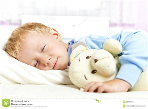 sleeping in my bed small child sleeping in bed stock photos image 26773763