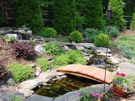 landscaping bridge garden bridge on pinterest ponds deer fence and small