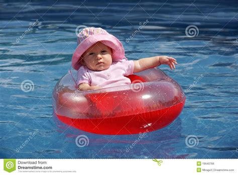 baby girl  plastic boat stock photo image  rescue