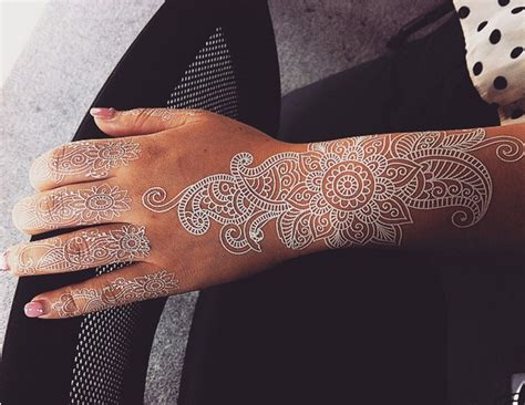 white henna style tattoos are the latest trend in