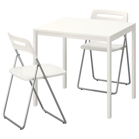 white folding table and chairs nisse melltorp table and 2 folding chairs white white 75