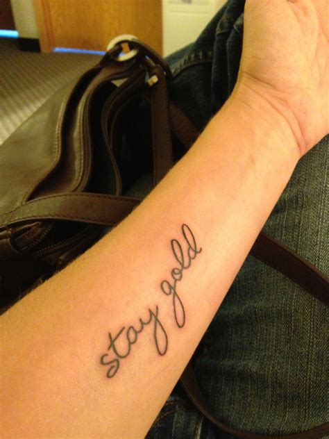 stay gold tattoo when im i want quot stay gold quot in cursive inside of a