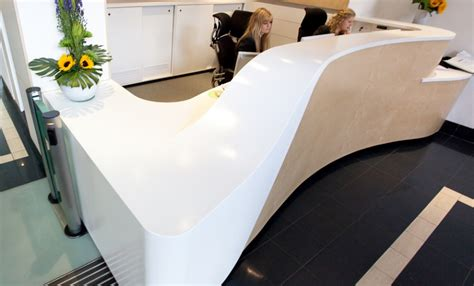 corian thermoforming bank s reception desk by solidity ltd using thermoformed
