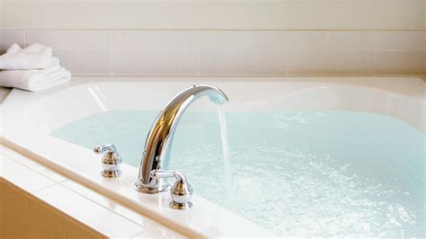 bathtubs and sinks have for the water to go down how do you change a roman tub faucet reference com