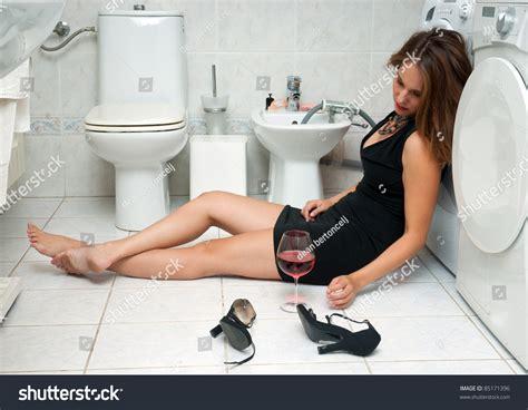 drunk girl in bathroom attractive drunk woman her bathroom glass stock photo