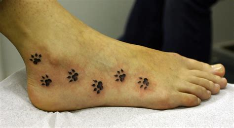 tattoo by foot paw print tattoos designs ideas and meaning tattoos for you