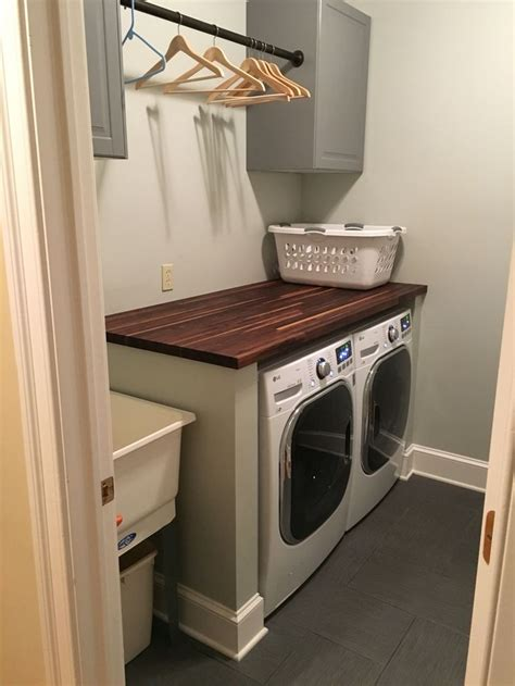 laundry room table top modern laundry room with gray cabinets and a butcher block folding table new home