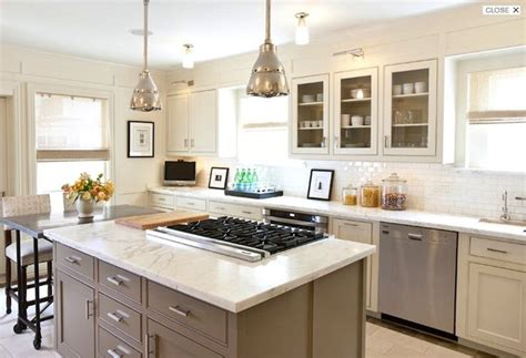 kitchen island cooktop two tone white taupe kitchen kitchen ideas countertops subway tile