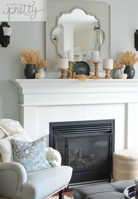 simple fall mantel with neutrals a pop of pretty