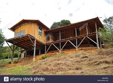 House Built Into Mountain by Wooden House Built On Stilts Into The Mountain And Made