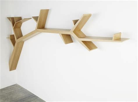 simple and stylish tree branch bookshelf made of wood