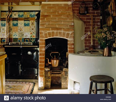 country kettle kitchen copper kettle on original brick stove in country kitchen