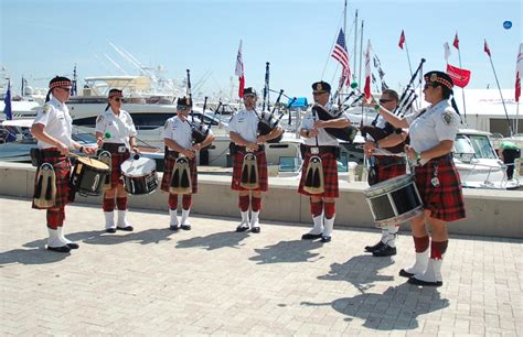 boat show band pipe and drum band takes to the docks at palm beach boat