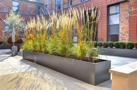 powder coated steel planters   courtyard
