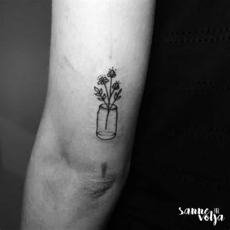 tricep tattoo pain flowers in a bottle on the tricep