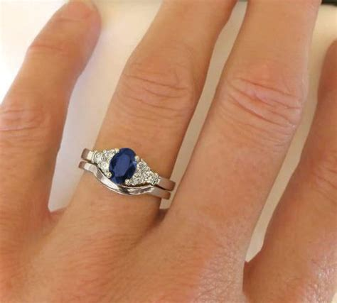 sapphire engagement ring with matching contoured