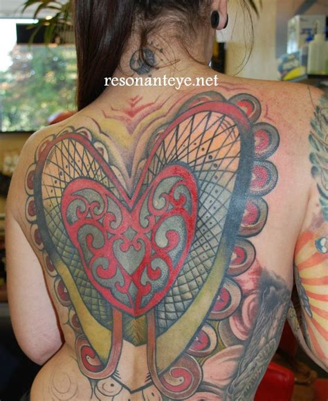 body electric tattoo piercing sacred geometry backpiece and scallops