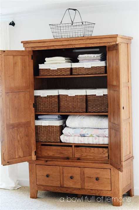 linen armoire storage linen closet organization a bowl full of lemons