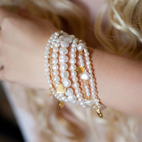 Pearl Amira amira seven row pearl and gold bracelet by ps with