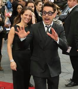 His leading lady! Robert Downey Jr passionately kisses his wife at Iron Man 3 premiere as