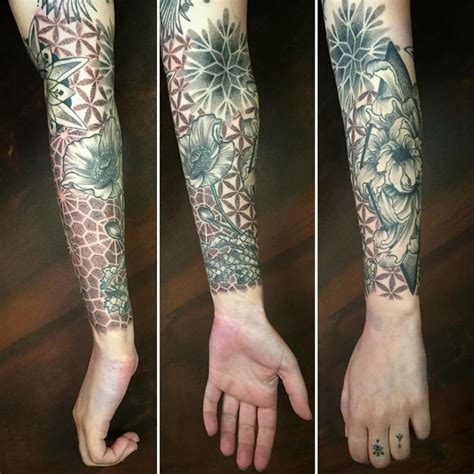 geometric tattoo elements sleeve with geometric elements and flowers in dotwork by