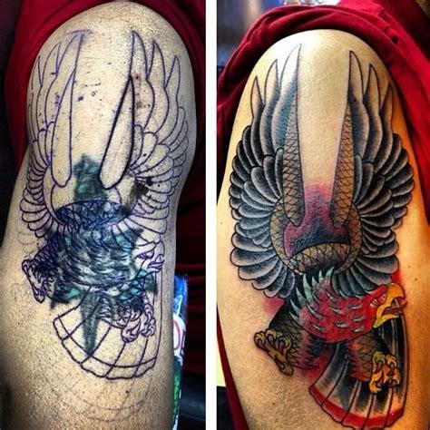 eagle tattoo cover up ideas tatuaż ramię old school orzeł cover up przez inkd chronicles