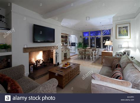 open plan living and dining room with plasma screen above